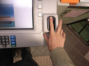 A biometric fingerprint reader can be attached to an ATM or other banking devices